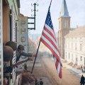 Kapetan Thomas H. Garahan vješa američku zastavu koju je napravila pripadnica francuskog pokreta otpora 1945.